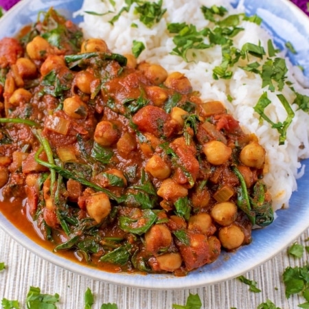 10 Minute Chickpea and Spinach Curry on a blue and white plate