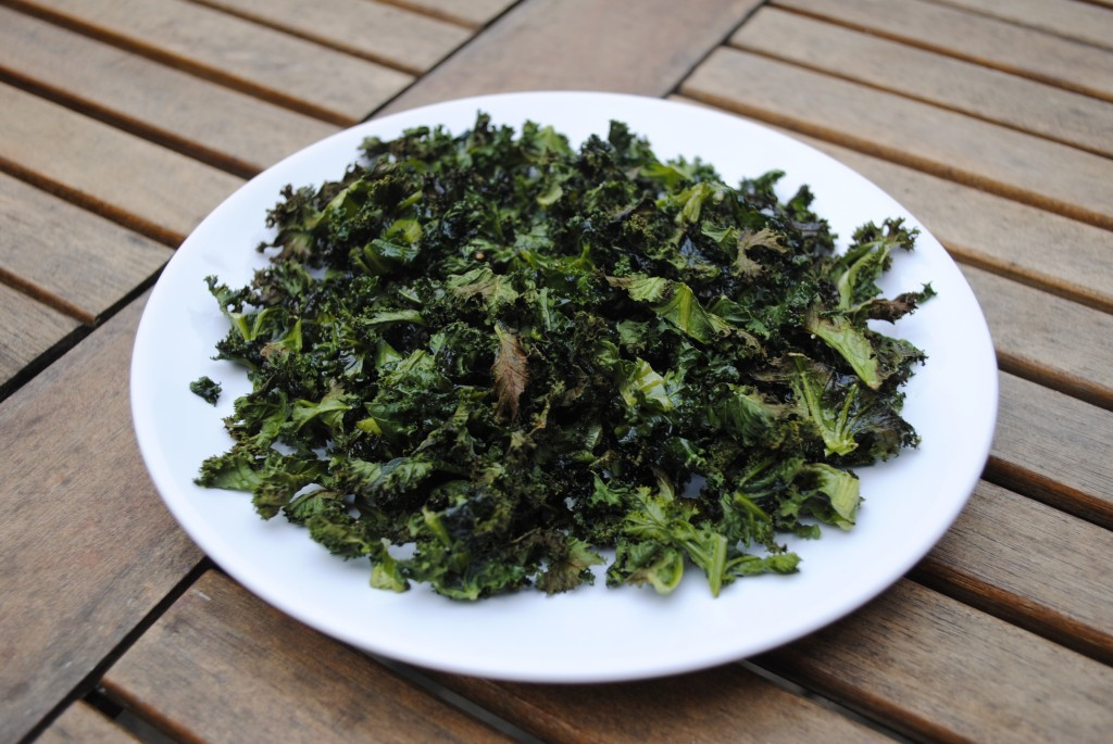 A plate of Kale on a wooden table