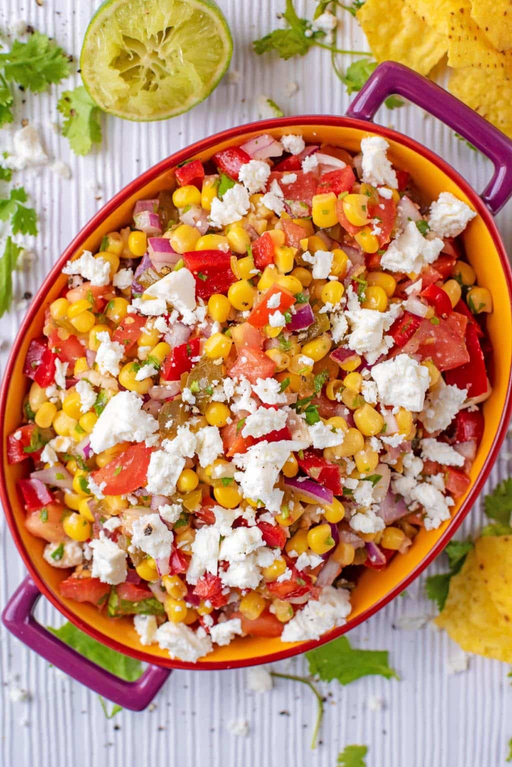 Sweetcorn Salsa in an oval dish topped with crumbled feta