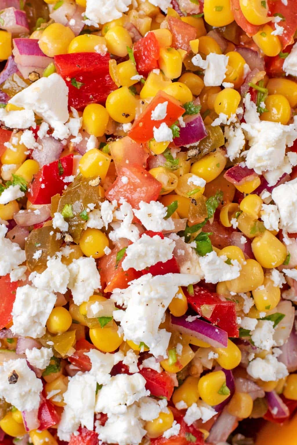 Sweetcorn, chopped peppers and tomatoes, herbs and feta