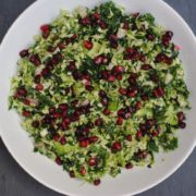 Kale and Brussel Sprout Salad in a large white bowl