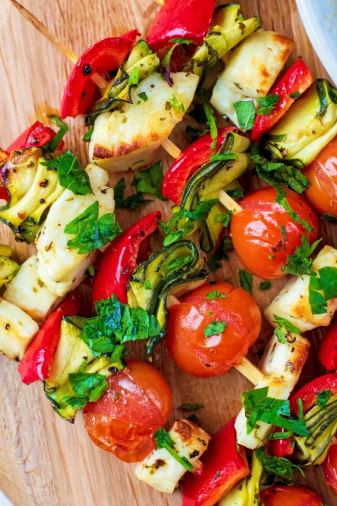 Vegetables and halloumi on wooden skewers