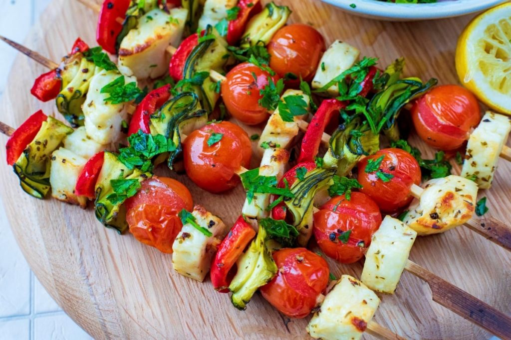 Vegetable and Halloumi Kebabs on a circular serving board