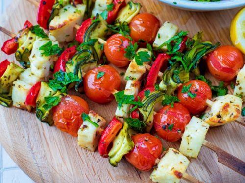 Vegetable and Halloumi Kebabs on a circular chopping board