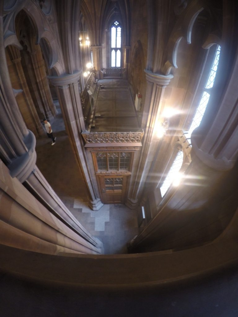 The view from a balcony of one of John Ryland's Library's many arched corridors