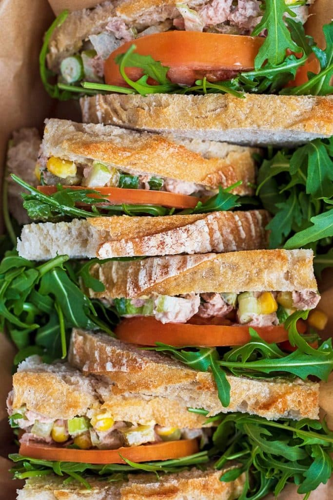 Tuna sandwiches stood up in a row