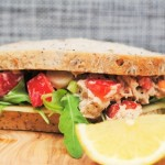 Loaded Tuna Sandwich in front of a grey background