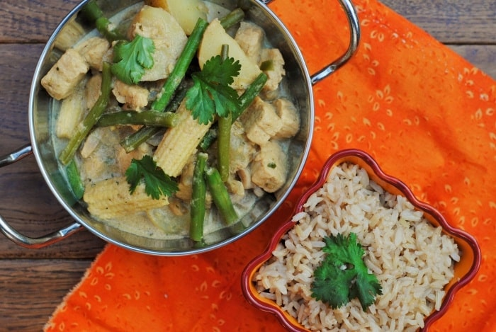 Thai Yellow Curry in a metal dish with a bowl of rice