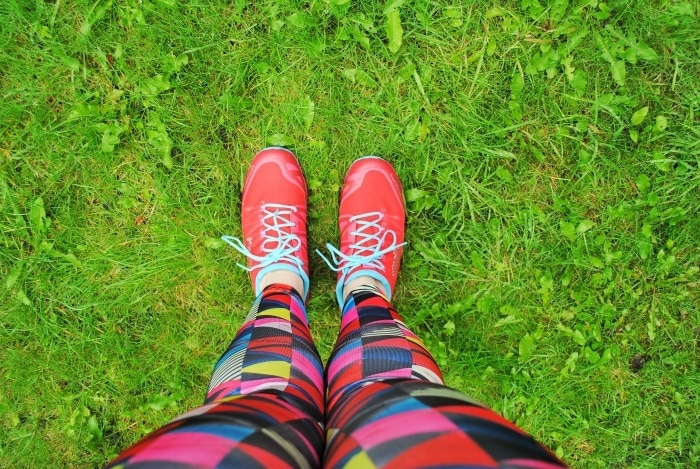 Red trainers on green grass
