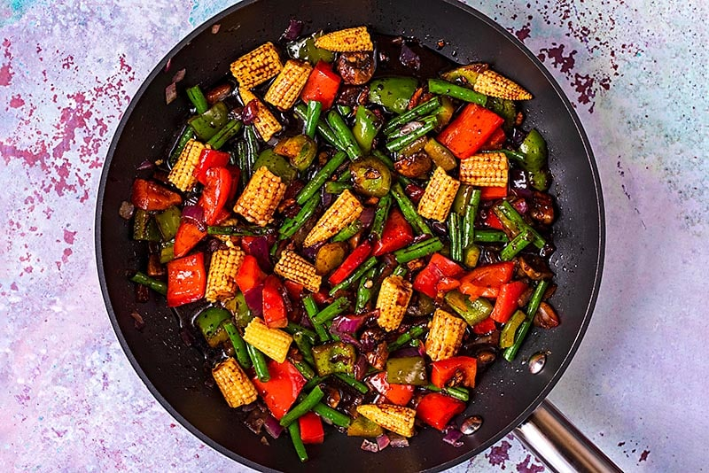 Chopped vegetables cooking in a teriyaki sauce