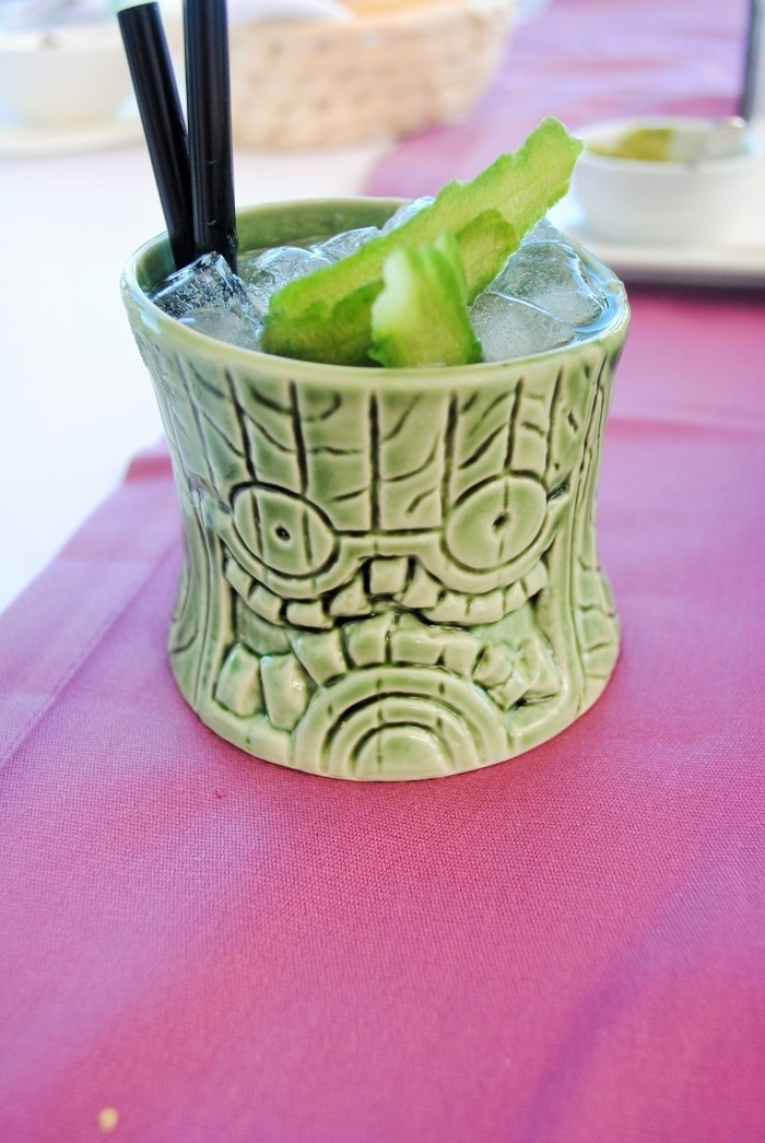 A cocktail in a tiki style cup