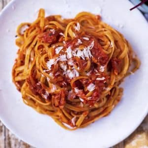Easy tomato pasta sauce coating tagliatelle on a white plate