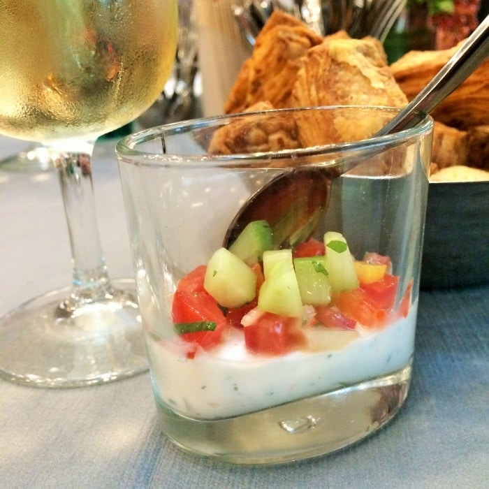 A glass filled with yogurt and fruit