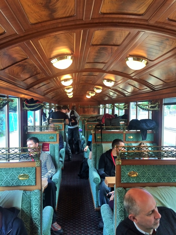 The interior of a very ornately decorated train carriage
