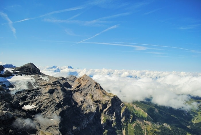 View of the Swiss Alps above the clouds