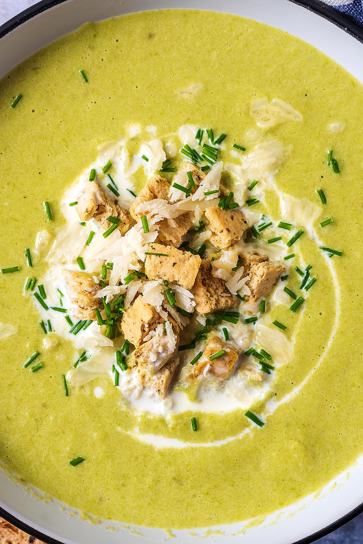 Croutons, and herbs floating on top of soup