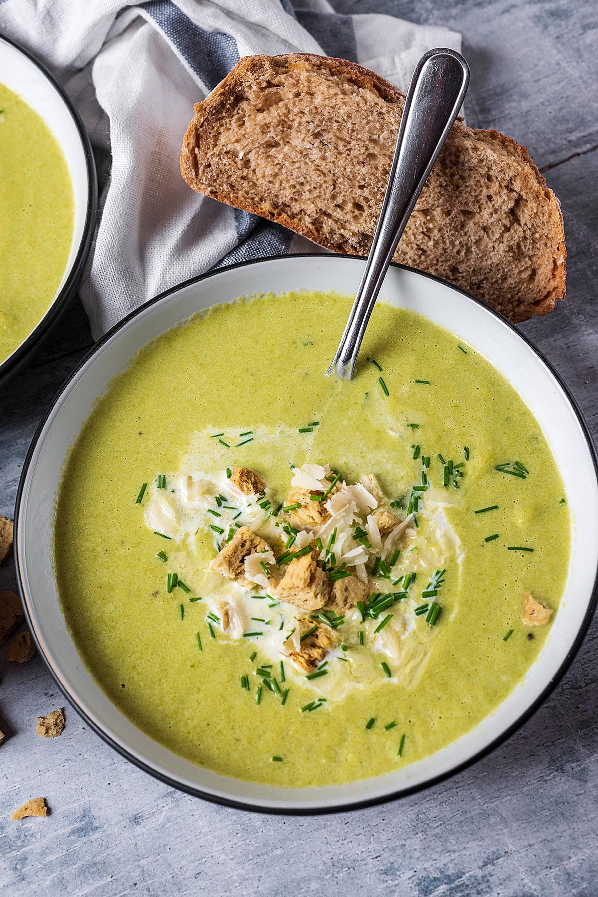 Asparagus soup in a bowl with a spoon