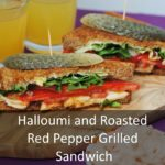 Halloumi and Roasted Red Pepper Grilled Sandwich on a wooden serving board