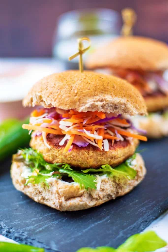 Salmon burger in a bun with lettuce and slaw