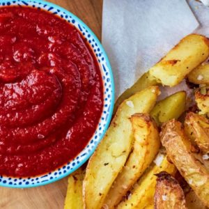 Healthy Tomato Ketchup in a small dish next to some seasoned fries