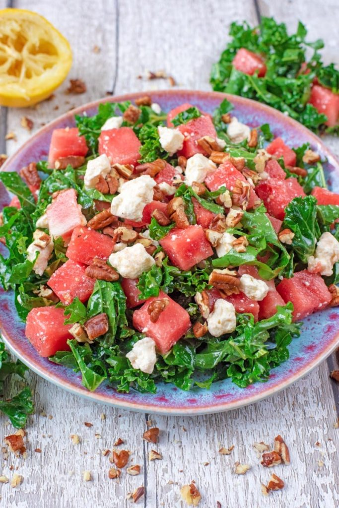A blue plate with Kale, Feta and Watermelon Salad