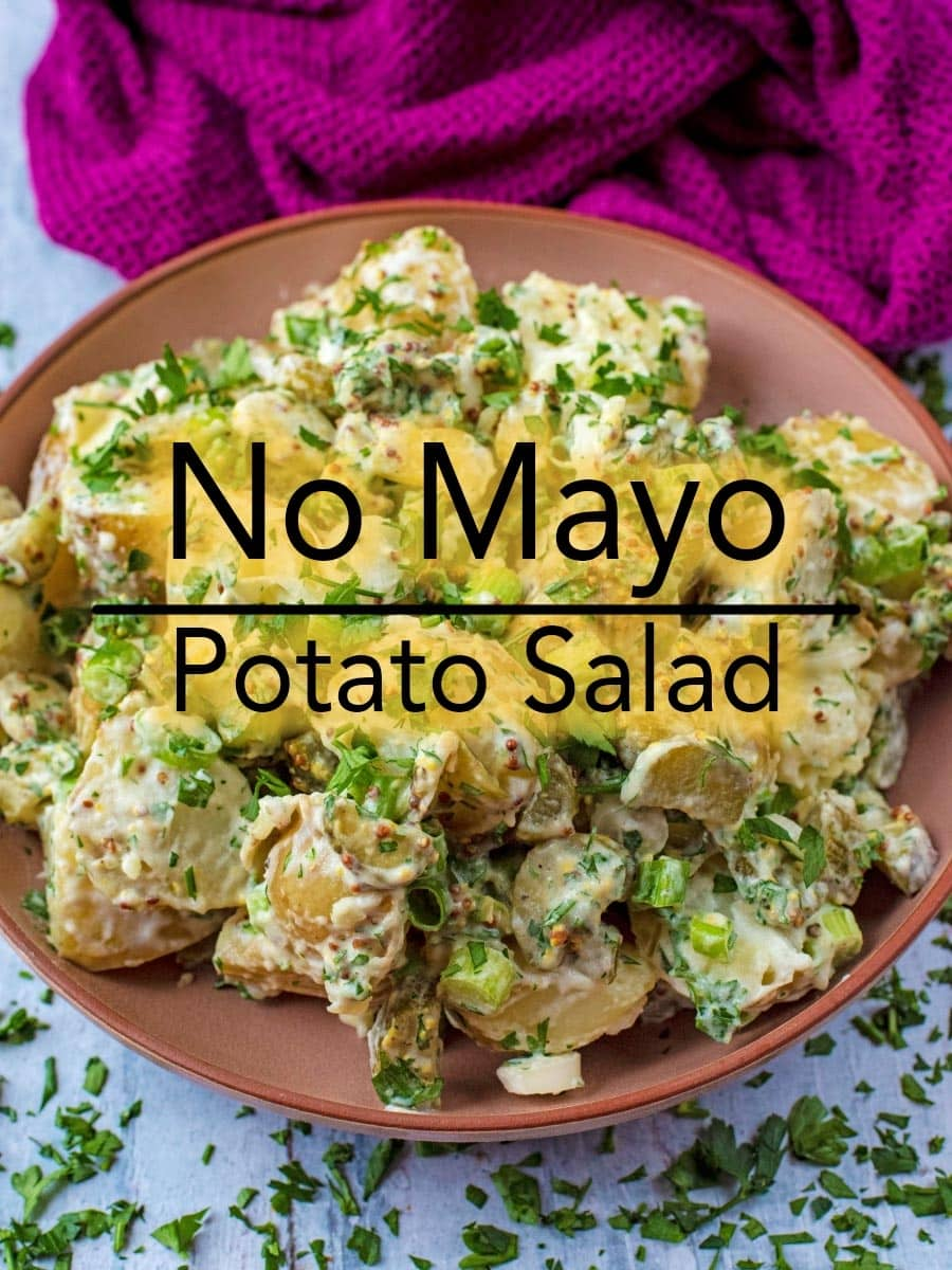 Our lighter No Mayo Potato Salad uses Greek yoghurt instead of mayonnaise, and is less than 150 calories per portion. If you want all of the flavour and creaminess from a potato salad, but less of the calories and fat, then give this potato salad with yoghurt a try at your next BBQ! #sidedish #potatosalad #bbq