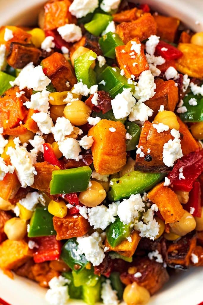 Cubes of sweet potato, chopped vegetables and crumbled feta