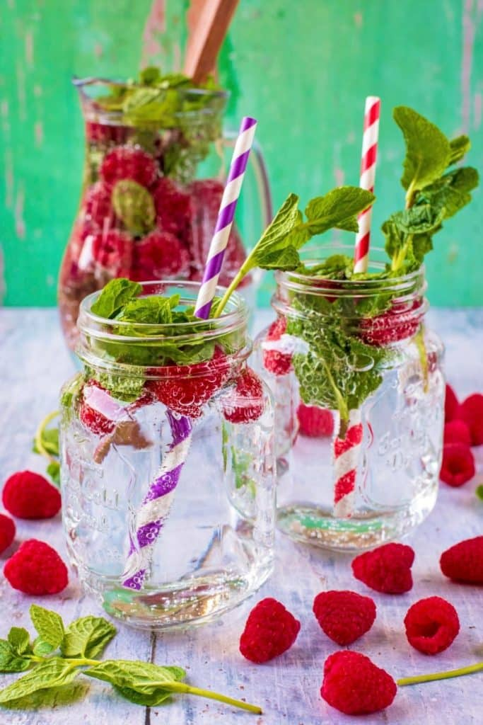 Raspberry and Mint Sparkling Water in two mason glasses