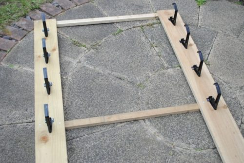 A timber frame with gutter brackets attached to it