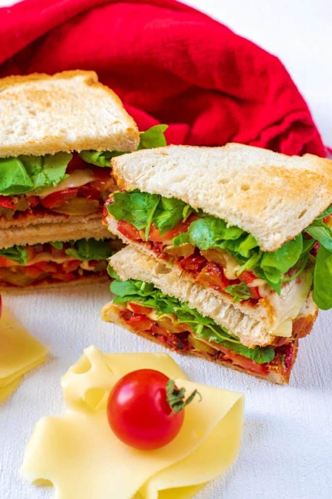 Vegetable Pizza Sandwich with a slice of cheese and tomato