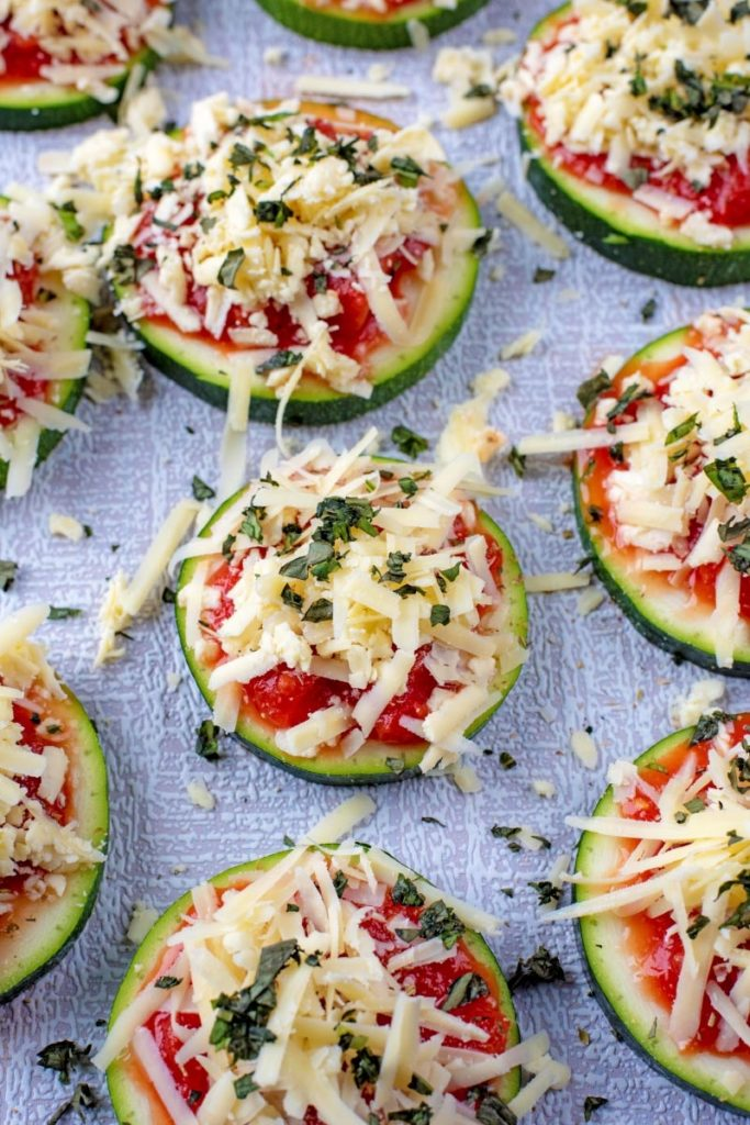 Slices of courgette with tomato and cheese on top