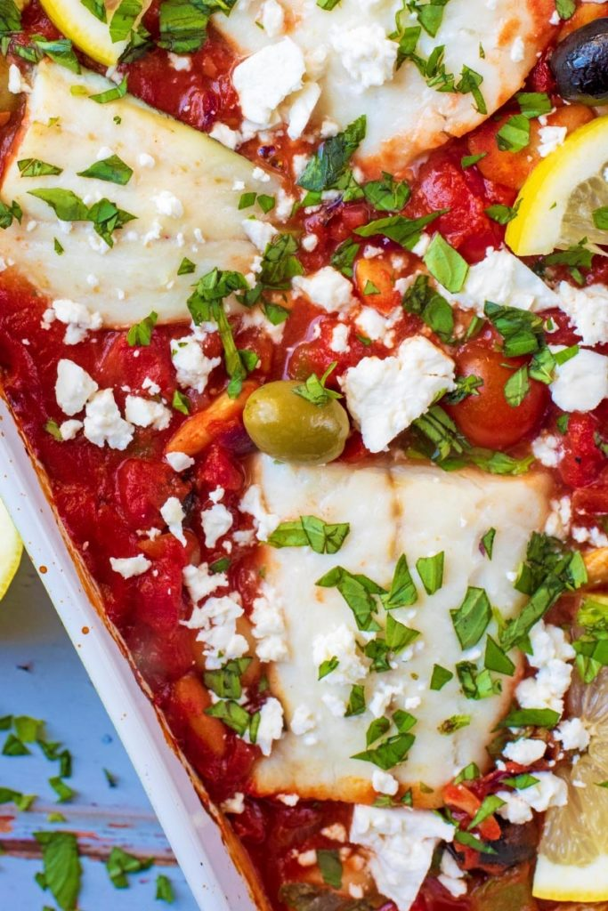 Cod in tomato sauce with olives and feta cheese
