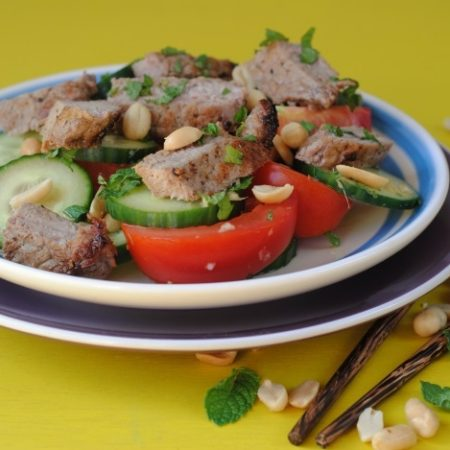 Thai Beef Salad on a blue and white plate