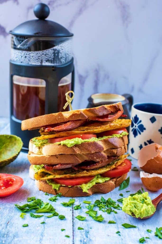 The Ultimate Breakfast Sandwich in front of a pot of coffee