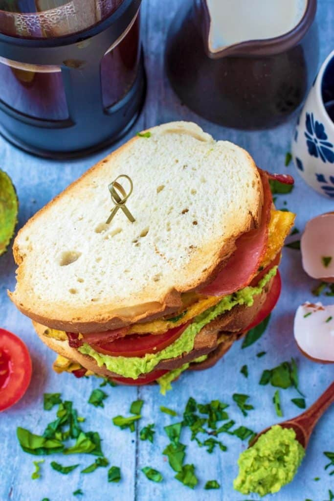 A Breakfast Sandwich showing avocado and tomatoes