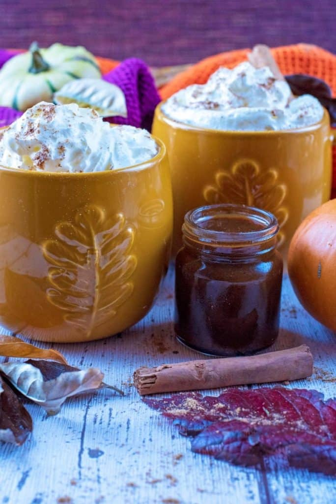 Two cream topped mugs of Pumpkin Spice Latte