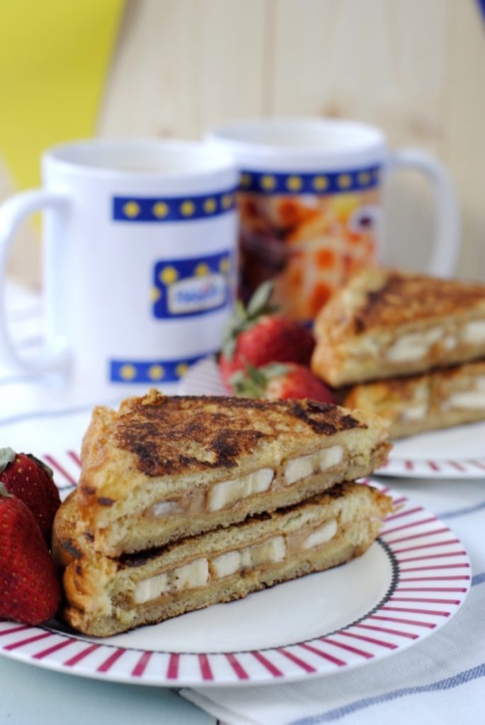 Banana and Almond Butter French Toast in front of two mugs