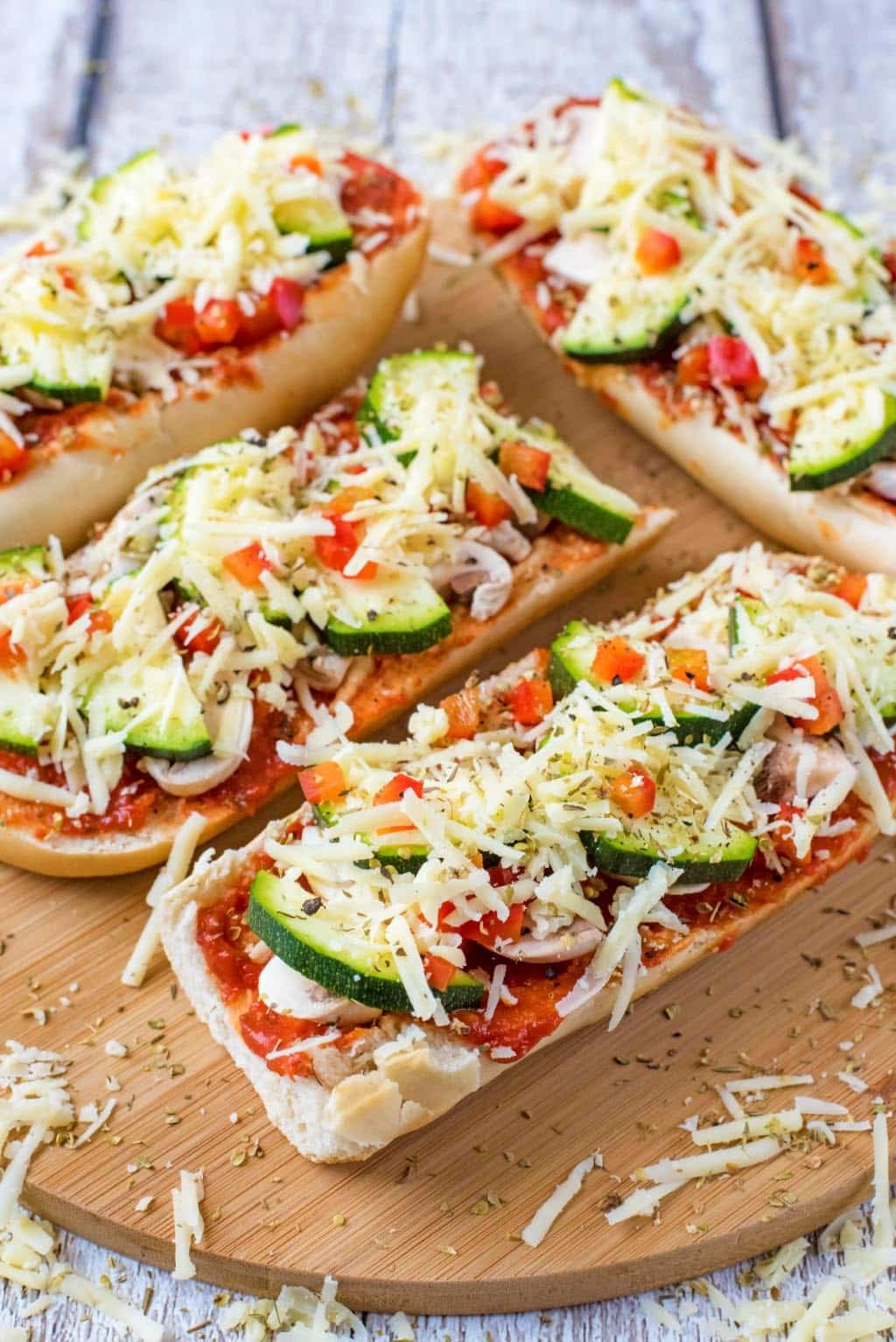 Vegetable pizzas on a serving board
