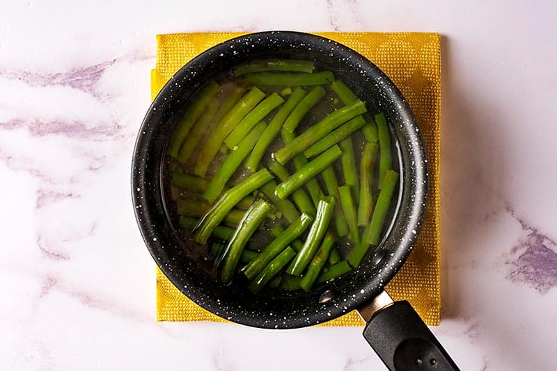 Green beans cooking in a saucepan