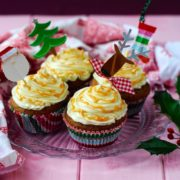 Four Gingerbread Cupcakes topped with frosting and Christmas decorations
