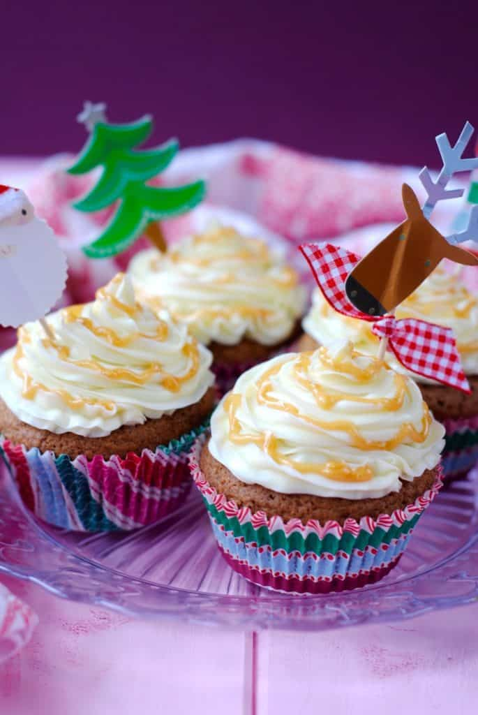 Gingerbread Cupcakes on a glass plate with christmas decorations