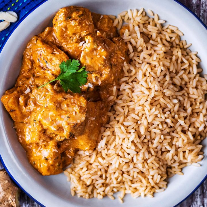 A plate of chicken korma and rice