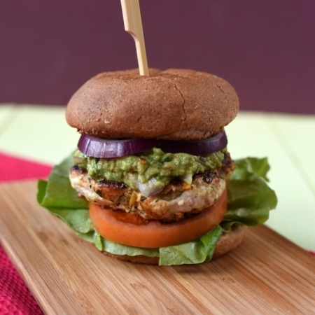 Chicken Guacamole Burger on a wooden serving board