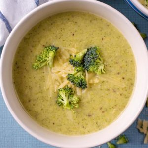 Creamy broccoli Soup with small florets of broccoli floating on top