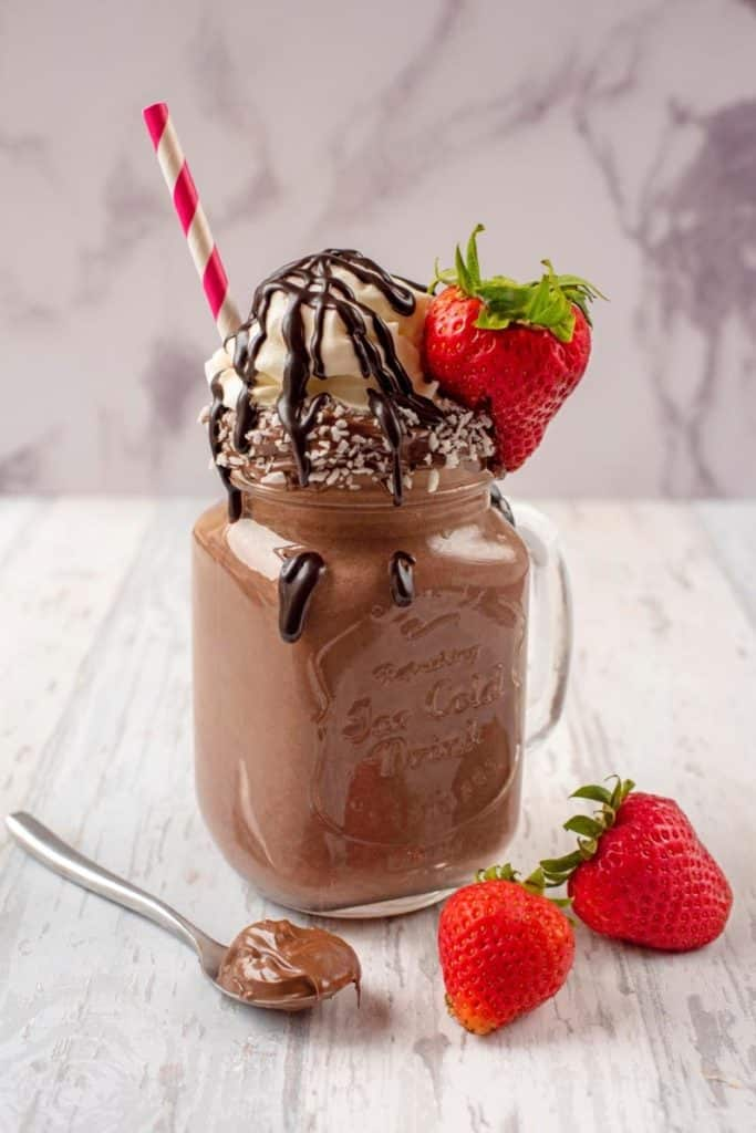 A chocolate smoothie in a mason jar