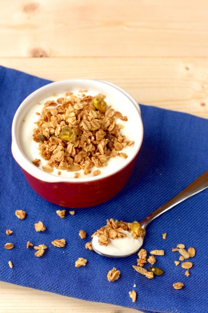 A small dish full of yogurt topped with some Granola