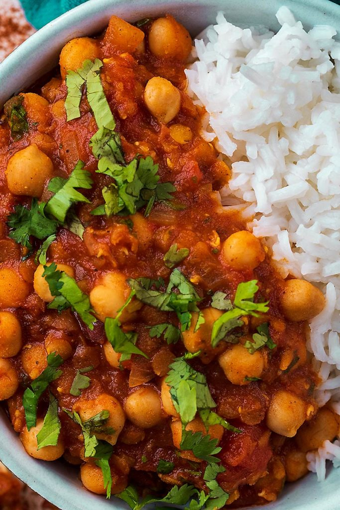 Chickpeas in a tomato sauce topped with chopped cilantro