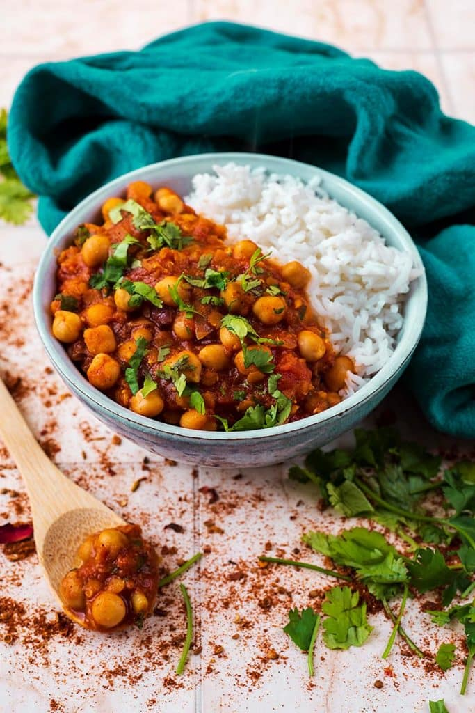 A bowl of chickpeas in a stew with rice