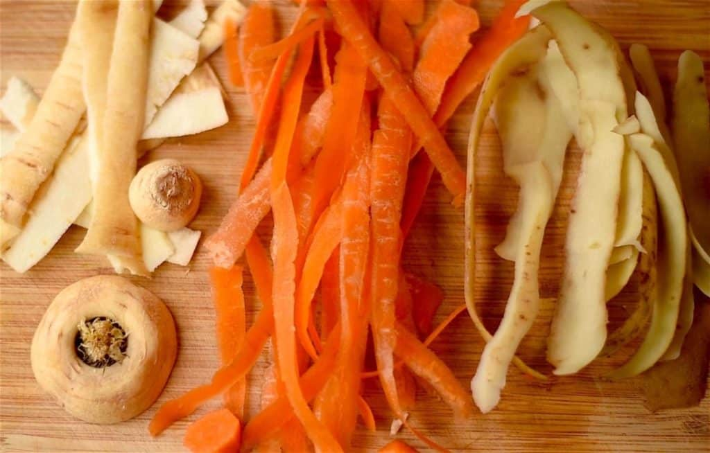 Parsnip, carrot and potato peelings on a chopping board