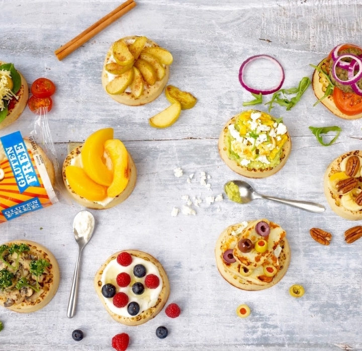 10 vegetarian crumpet toppings surrounded by spoons and food items